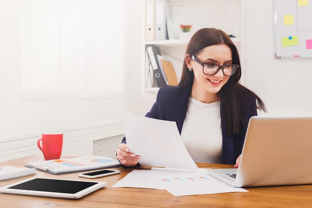 woman-working-at-desk-caliper