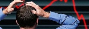 man reacting stock market dropping