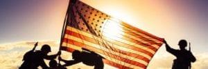 veterans raising a flag