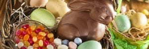 chocolate Easter bunny with jelly beans and eggs in a basket