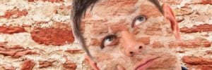 man with bricks on his face