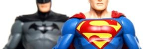 superman action figure with batman right behind him